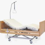 Łóżko rehabilitacyjne elektryczne Magda z wyposażeniem w obudowie drewniane przeznaczone do opieki długoterminowej nad pacjentem